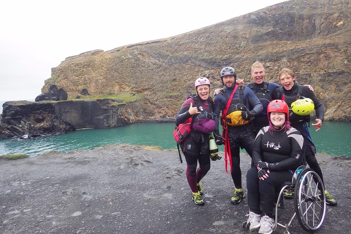 Photo taken after an accessible coasteering adventure at Blue Lagoon Abereiddy in Pembrokeshire. Accessible Outdoor Activities in Wales
