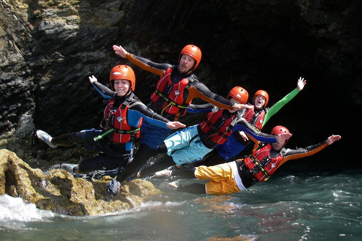 Students Coasteering, a popular adventure activity with college & university groups in Wales