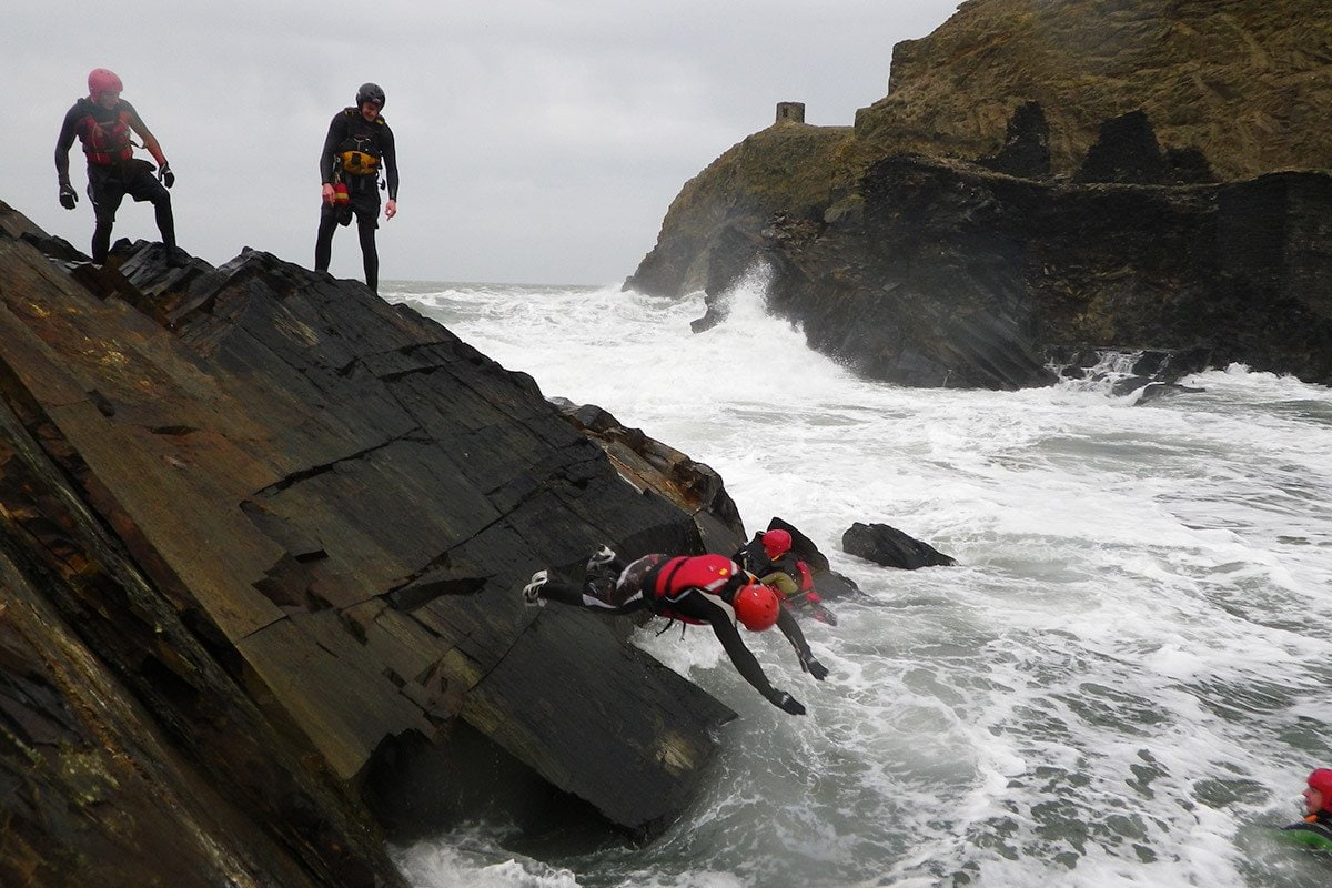 Low level cliff jumps. Coasteering at the Blue Lagoon, Abereiddy Wales