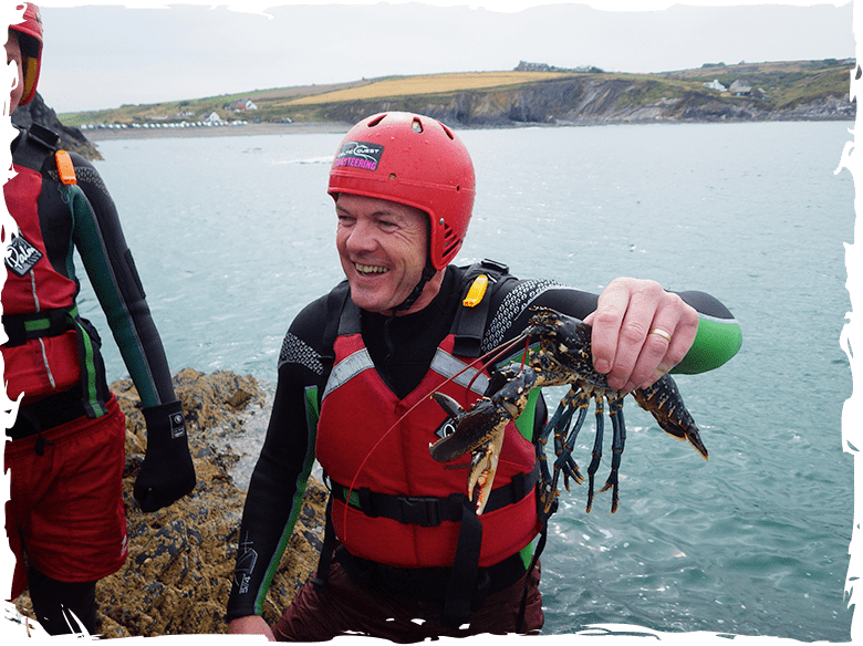Finding a lobster while coasteering in Pembrokeshire