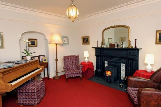 Cefn-Y-Dre Lounge with log burner and mini grand piano