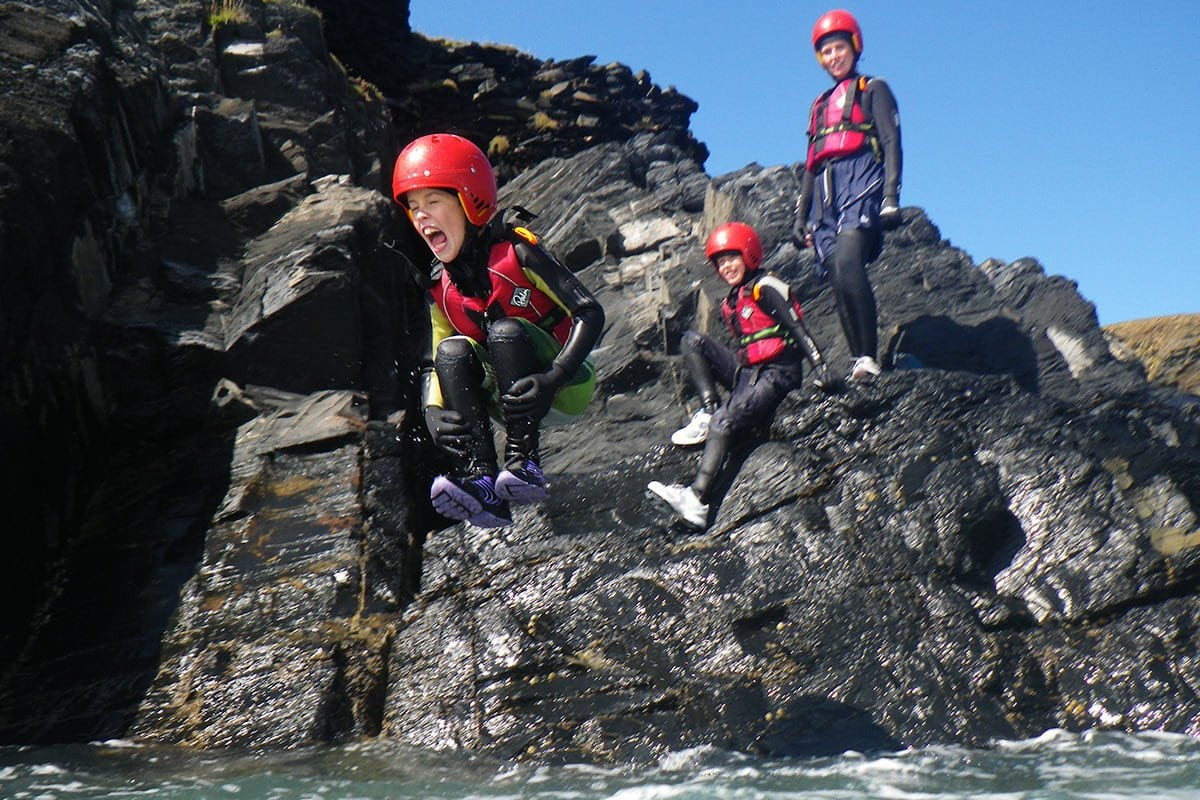 Children & teenagers cliff jumping, outdoor adventure acitivities in Wales