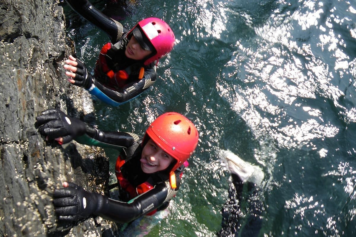 Coasteering for children & teenagers. Exploring the Pembrokeshire coast near St Davids, Wales