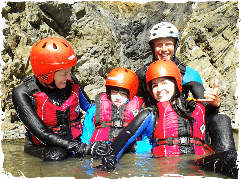 Boy with cerebral palsy, disabled coasteering in Pembrokeshire Wales