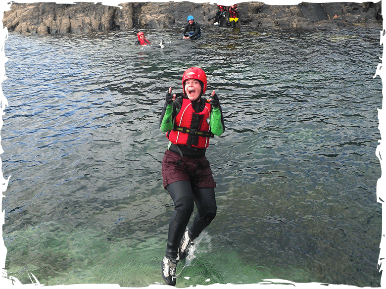 Falling into the sea while coasteering in Pembrokeshire Wales