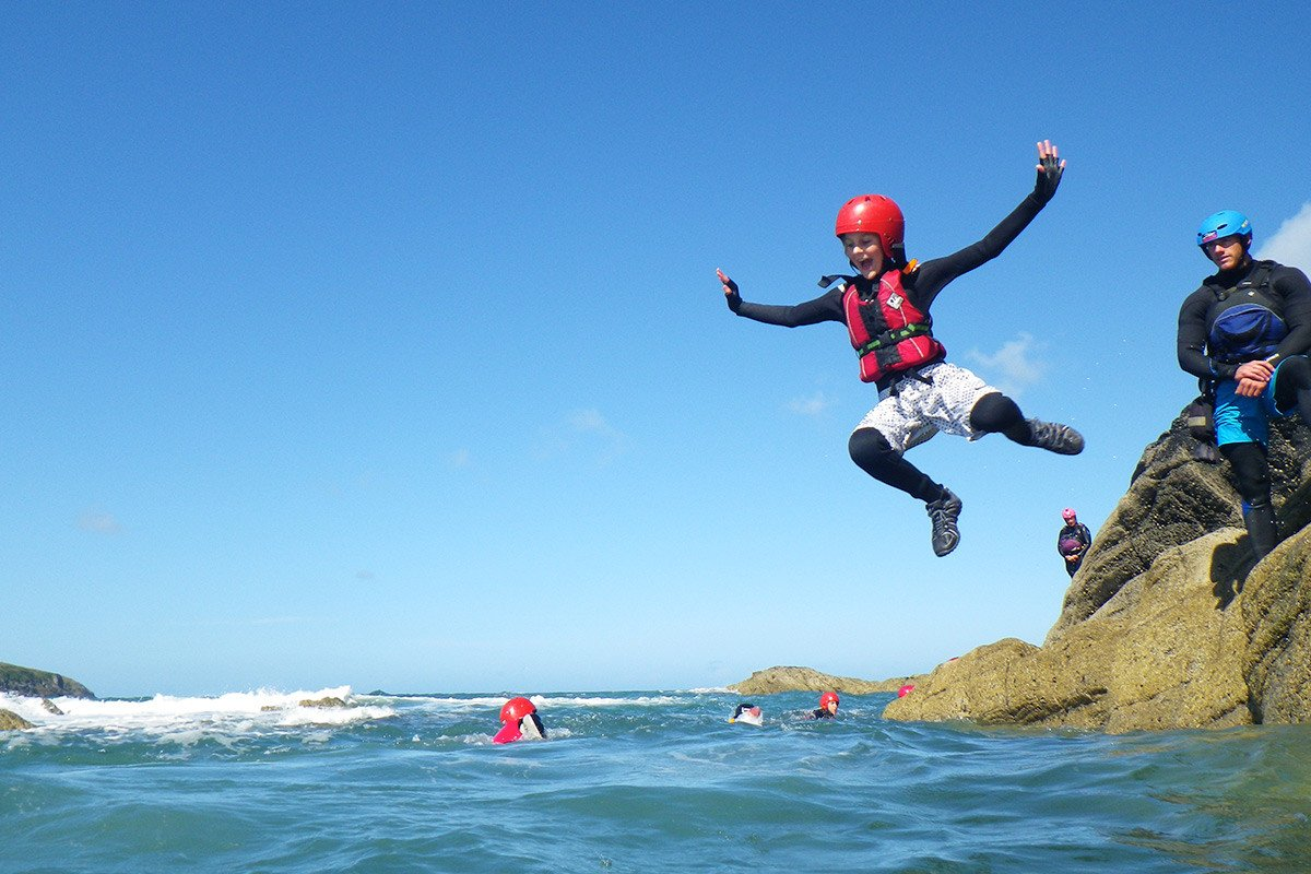 Family Coasteering in Pembrokeshire! A fun family day out in Wales, whatever the weather, you're going to get wet!