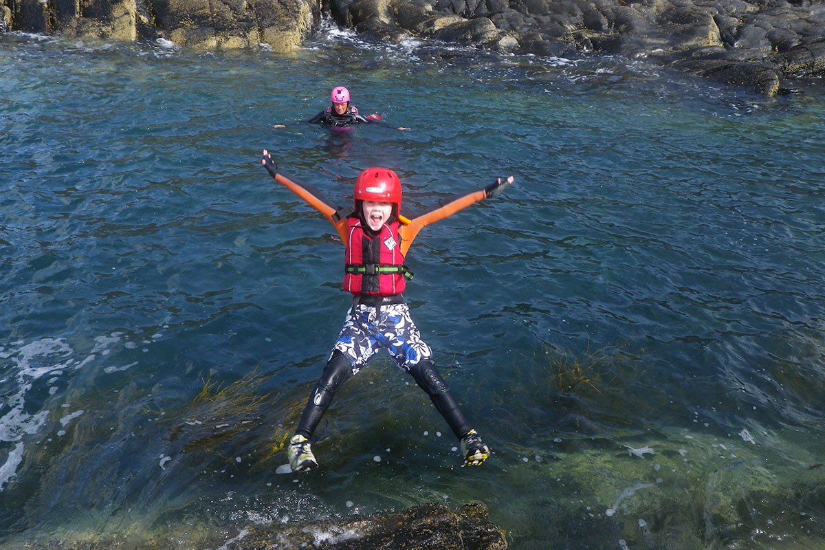 Children pull some epic shapes when jumping in the sea. Especially when they learn to trust the super floaty equipment and our specialist Coasteering Guides