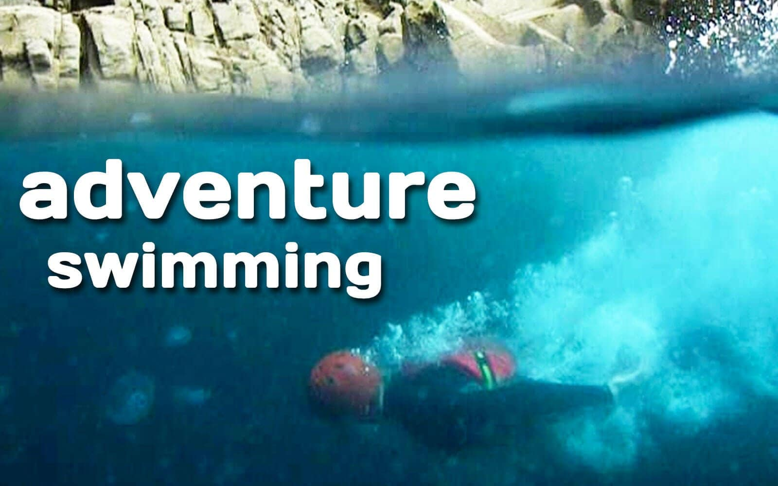 Wild swimming and adventure swimming underwater in the clear blue water of Pembrokeshire Wales