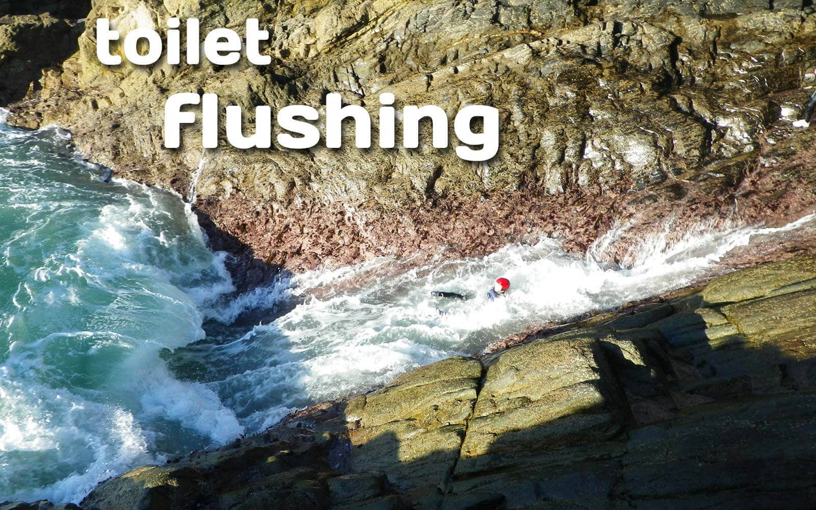 Rough water Coasteering in Pembrokeshire Wales, take a spin in the toilet flush and washing machine