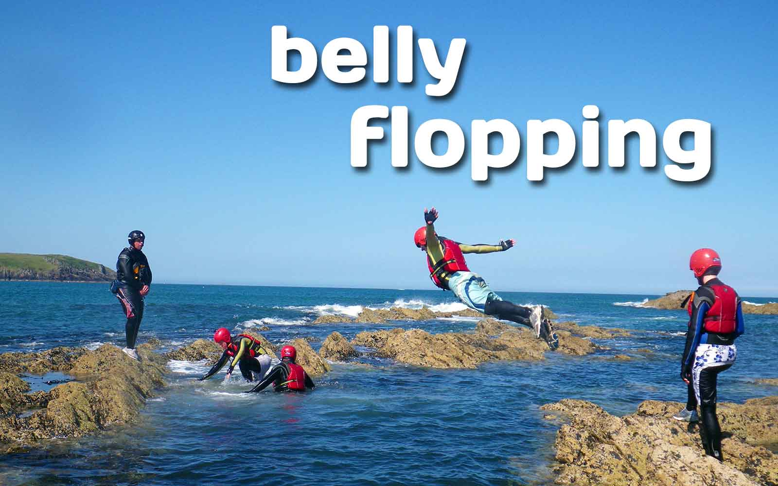 Belly flopping from the lower cliff ledges into Wales' sea on the Pembrokeshire coast