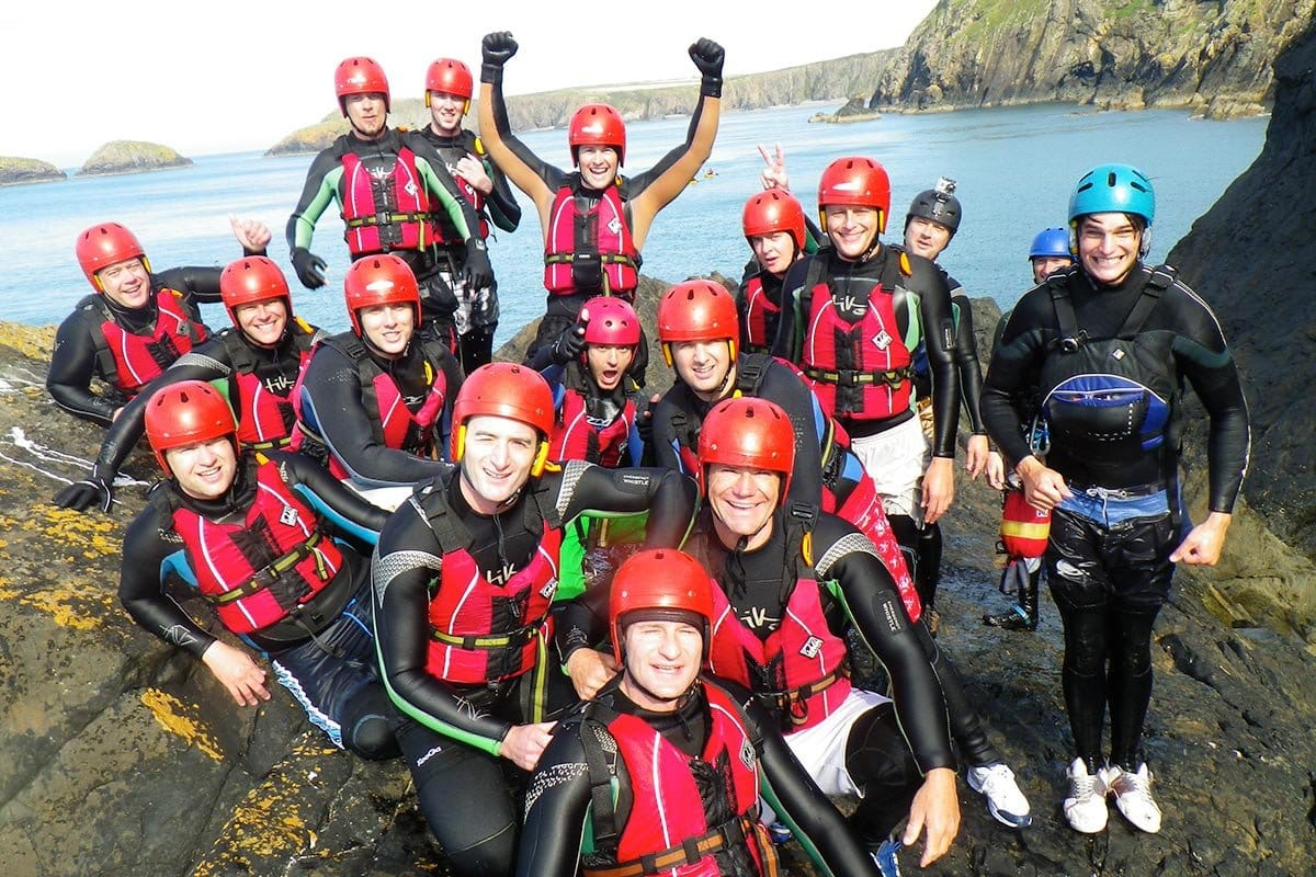 Stag party posing for a photo on Abereiddy headland while Coasteering with Steve Backshall