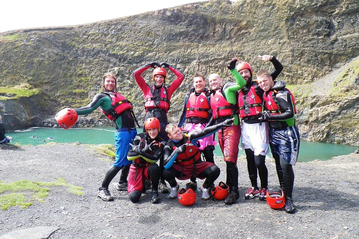 Stag party posing for a photo after their Coasteering adventure at the Blue Lagoon, Wales