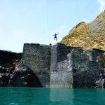 Nick jumping while Coasteering at Abereiddy Blue Lagoon
