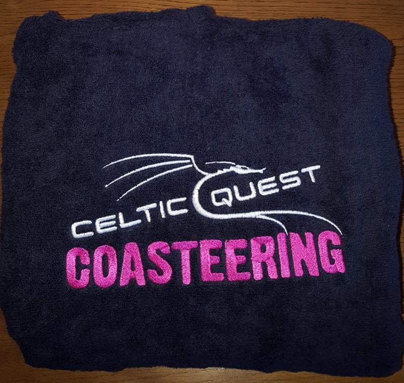 Celtic Quest Coasteering logo embroidered on chest of Coasteering towel changing robe