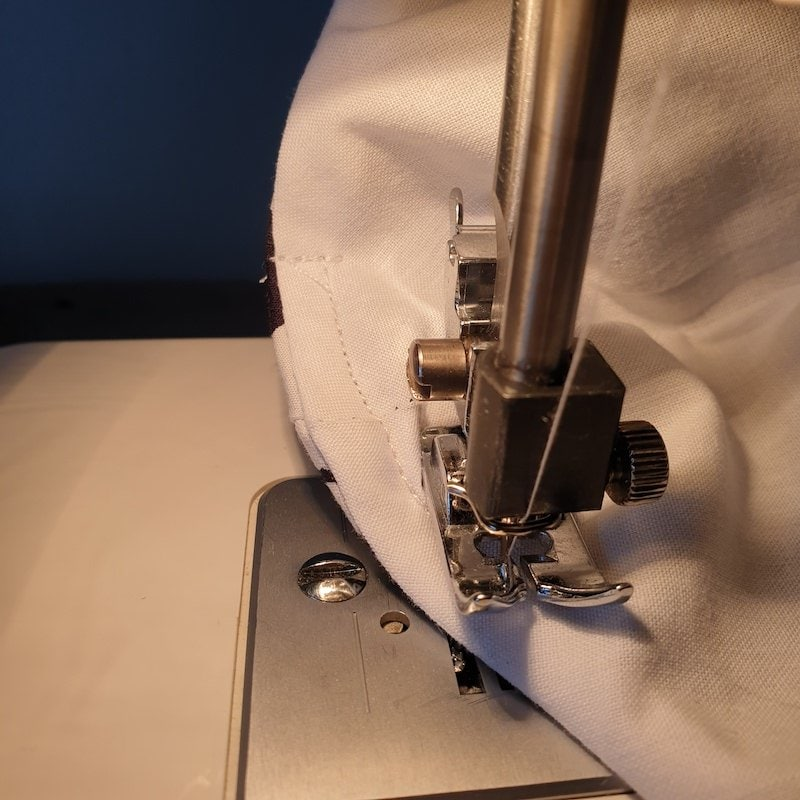 Sew a pocket for nose wire, insert wire, sew end of pocket closed. Be careful not to sew over the wire, sewing machine needle doesn't like it!